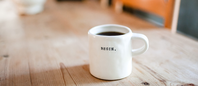 coffee cup that reads 'begin'